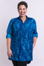 Women's teal blue batik art 3/4 sleeve V-neck blouse tunic with small collar, pockets, and round hemline.
