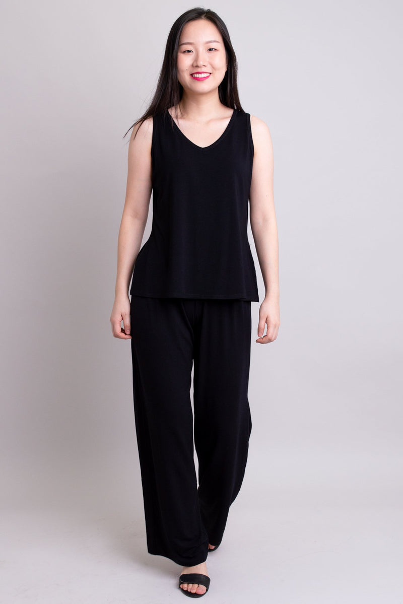 Women's high waisted comfortable tall black flowy pants with gathers at the waist. Tank top and pant set for yoga or casual wear.