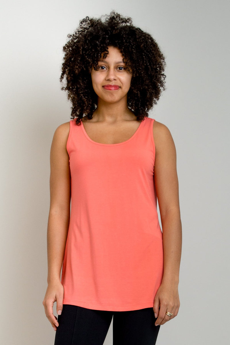 Women's coral pink spring/summer casual flowy tank top with wide shoulder strap and U-neckline.