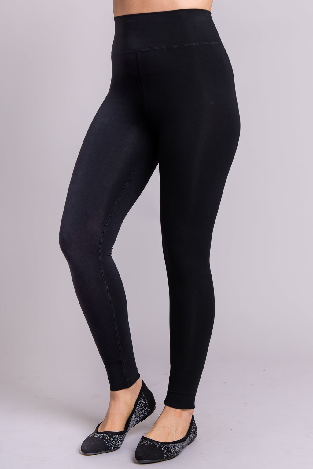 Women's basic petite black high-waisted legging for casual or workout wear.
