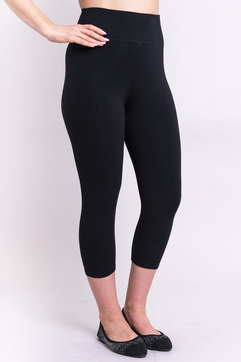 Women's basic and comfy black cropped legging for casual or workout wear.