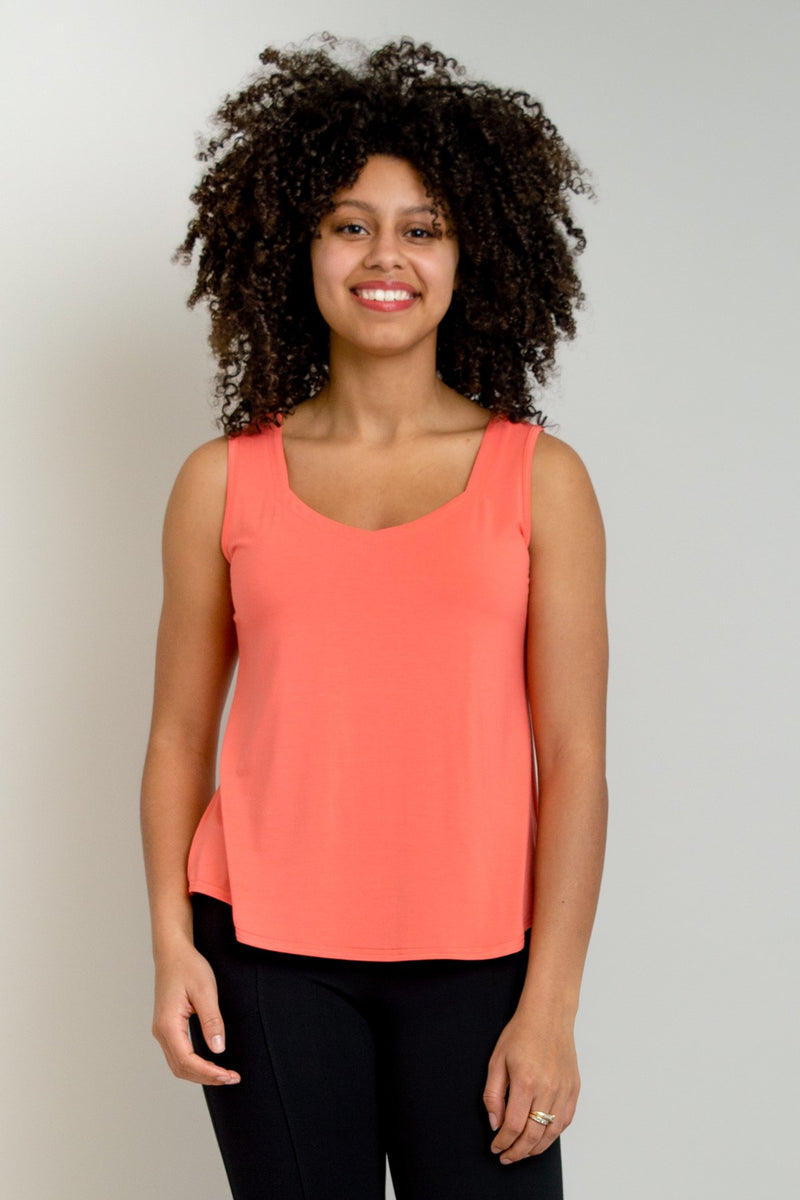 Women's coral pink short bodice sweetheart neckline tank top shirt with wide shoulder straps.