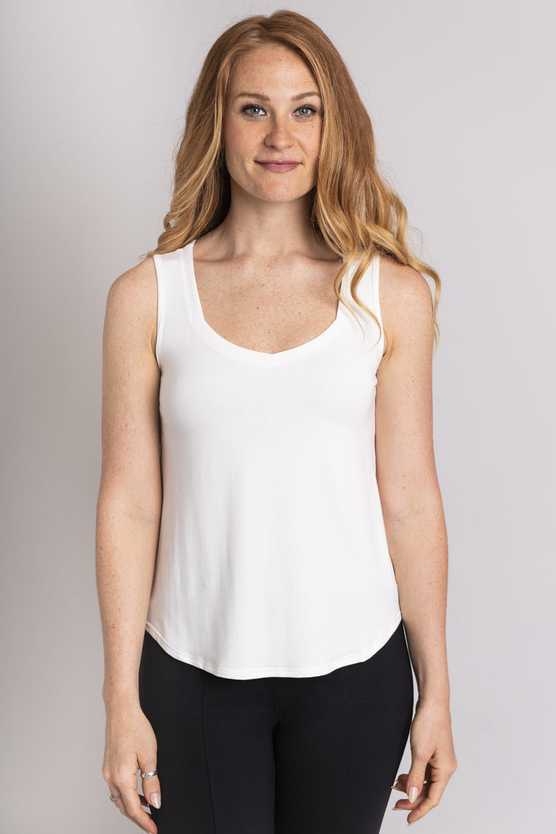Women's white short bodice sweetheart neckline tank top shirt with wide shoulder straps.