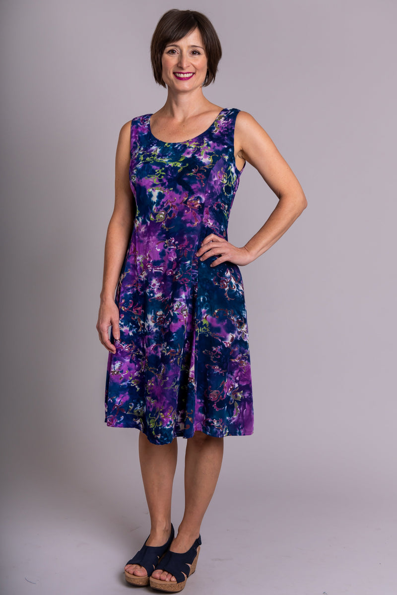 Women's purple palace print sleeveless short summer dress with fitted bodice and round neckline.