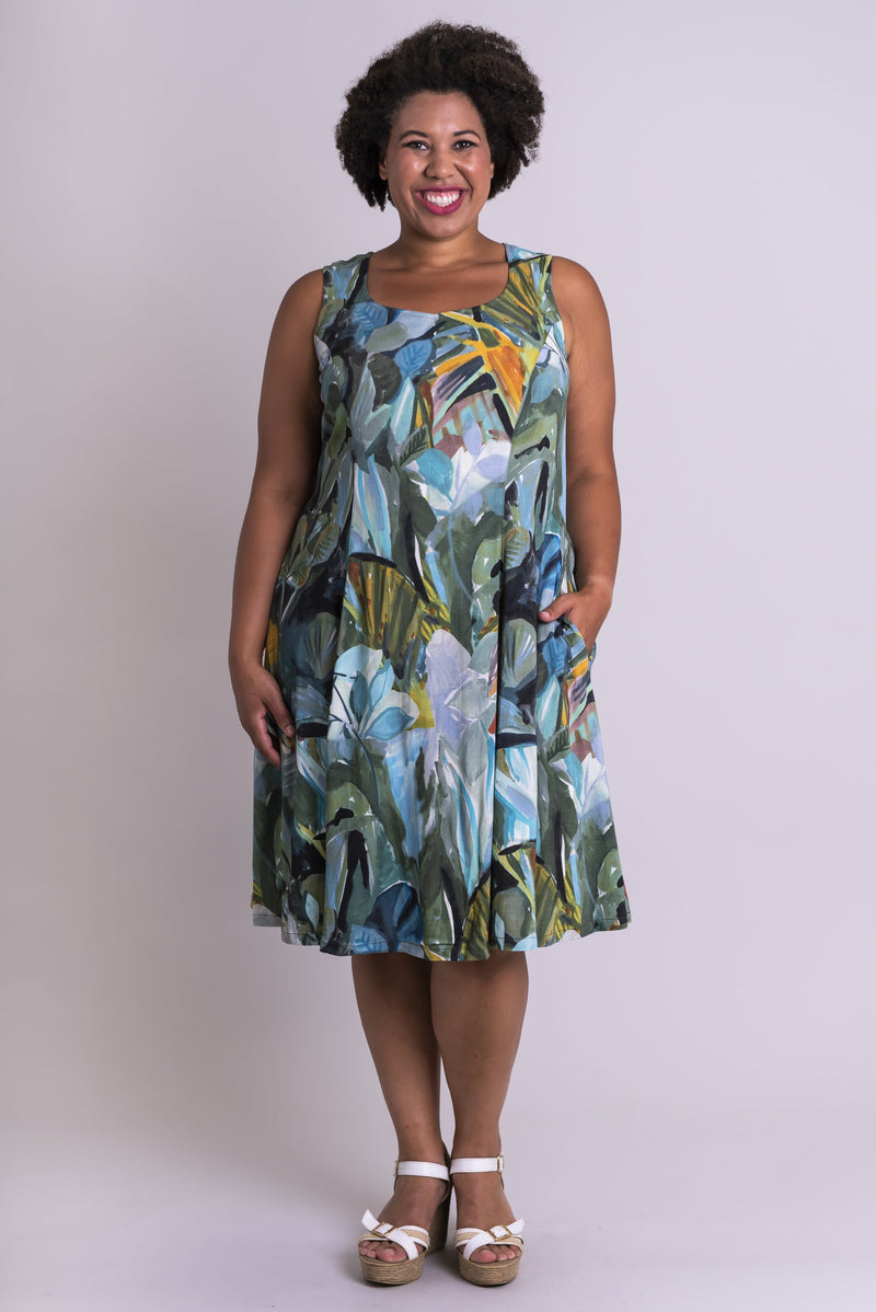 Women's green room plant print knee-length sleeveless dress with sweetheart neckline and pockets.
