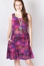 Women's magenta print knee-length sleeveless dress with sweetheart neckline and pockets.