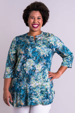 Women's blue sprig print 3/4 sleeve tailored blouse with V-neck and small band collar.