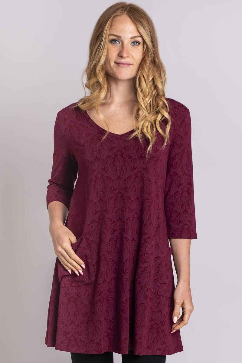 Women's burgundy red 3/4 sleeve V-neck tunic dress with pockets.