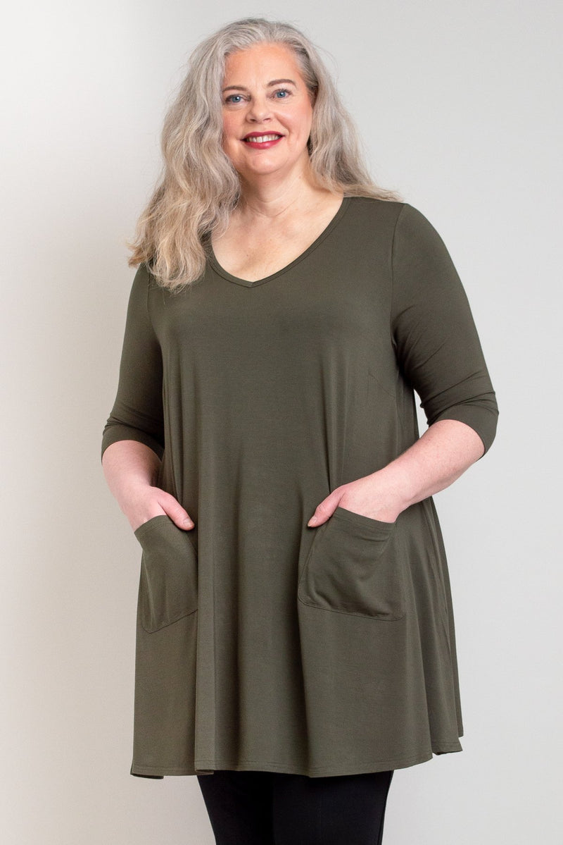 Women's khaki green plus-size V-neck tunic dress with pockets. Made with sustainable and natural fibers, fair-trade.