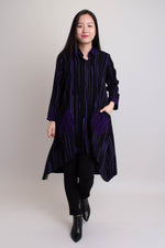 Women's violet stripe batik art print long-sleeve long button-up dress shirt jacket with buttons and collar.