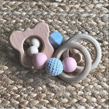 a blue, white and pink pregnancy and infant awareness butterfly teether rattle
