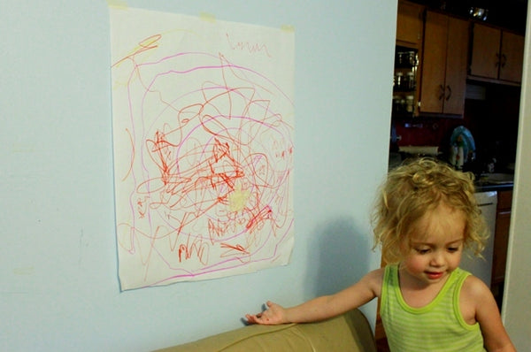 Little girl shows off her artwork!