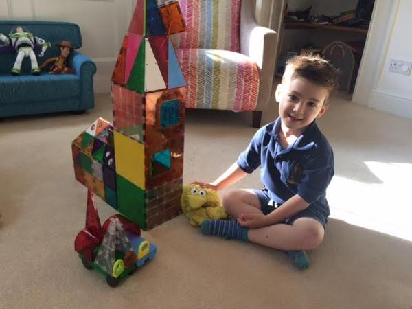 Building with the best toys Magna Tiles in action for sale at Little Citizens Boutique