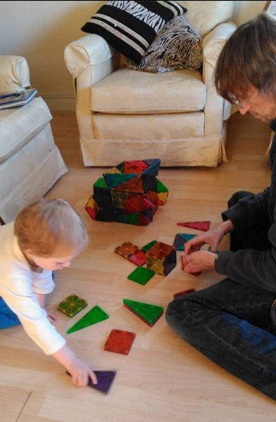 Kids playing with building toy Magna Tiles for sale at Little Citizens Boutique