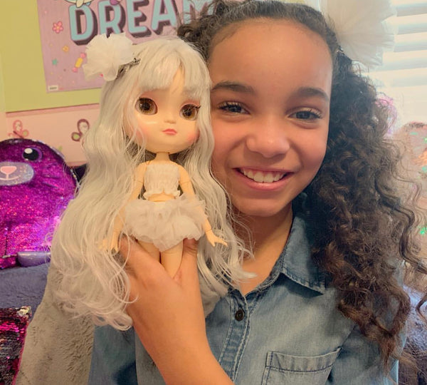 Watch This! Dolly influencer @kherringtonbriggs shared Angela Doll box opening.