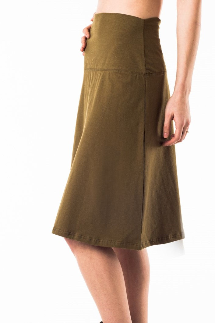 So comfy and cool you'll never want to take it off! A-lined wide waistband skirt in green worn high, mid or low. Eco natural organic cotton hemp fabric. Slow fashion made with love in Vancouver BC.