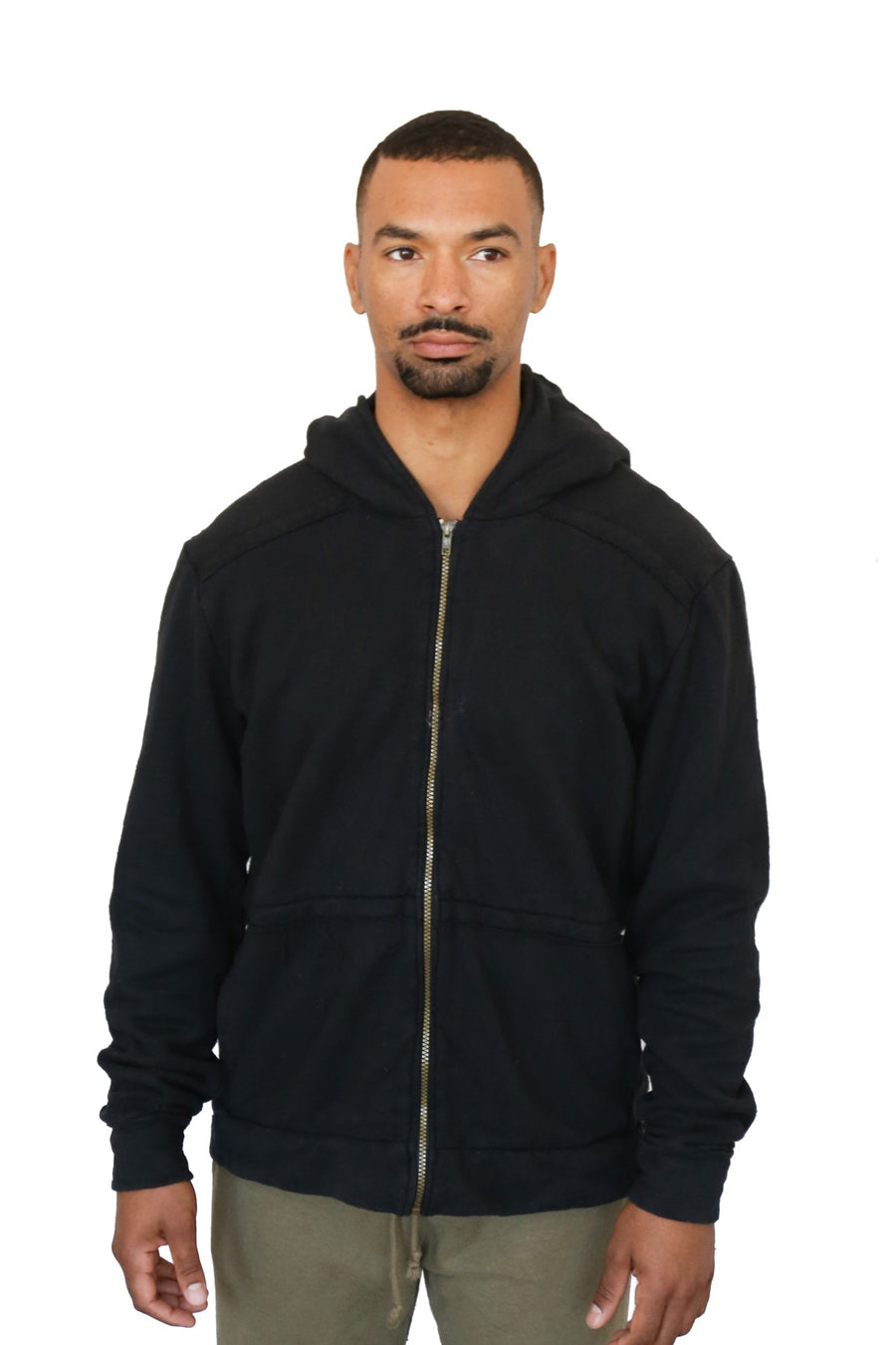 Stay cosy with this men's eco fleece organic cotton hemp hoody in black. It sports side pockets and thumb holes in the cuff. Slow fashion ethically made on the west coast in Canada.