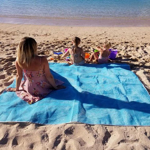 Made of a soft, dual-mesh material, our Sand-Proof Beach Mat lets dirt and sand particles fall right through it, without sticking to anything! The mat even keeps dirt and sand underneath it from coming back up the other way. Perfect for sports events and outdoor recreation, the Sand-Proof Beach Mat is a must-have item for all your Spring and Summer activities!  Patented Sand-Free Beach Mat: Experience this sand-proof phenomenon for yourself. So soft and comfortable, this mat is better than any towel or regular picnic blanket that you can find and the softer material is easily folded into a small carry bag. The unique and patented technology delivers a completely sand-proof experience.   Not Just for the Beach: The light-weight, quick-dry material is extremely versatile, so you can use it for so much more than just a fantastic Sand-Proof Beach Mat. It's ideal for camping, picnics, sporting events and outdoor occasions. Spill your drink? That's an easy fix! Spilled drinks will bead on the surface allowing you to wipe them away quickly and easily.   Windy Days: Due to the mats unique construction, the openings in the dual-mesh weave allow wind to pass right through the mat rather than causing it to fly up on windy days.  Dimensions: 200X200CM  Colors: Choose from Blue, Green or Pink