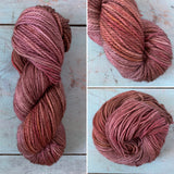 This yarn in a warm brown variegated, and layered with orange and plum purple.