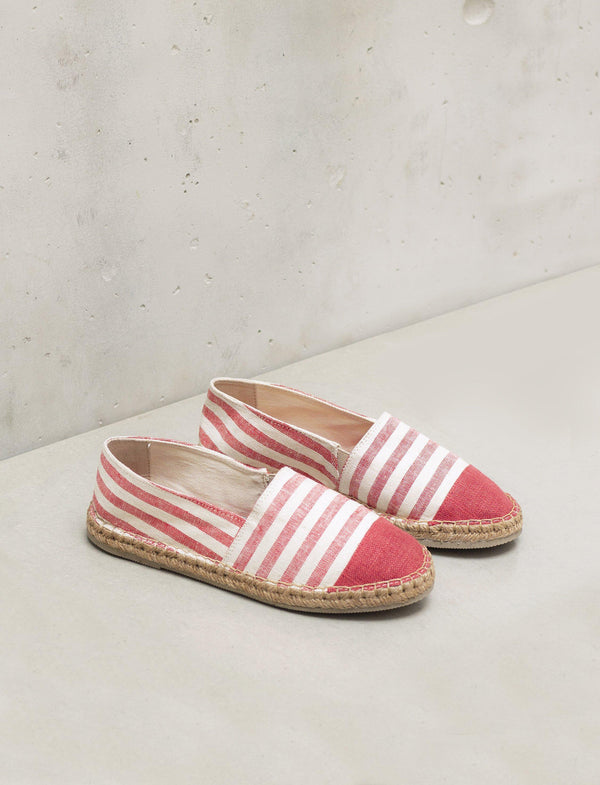 A pair of red and white espadrilles
