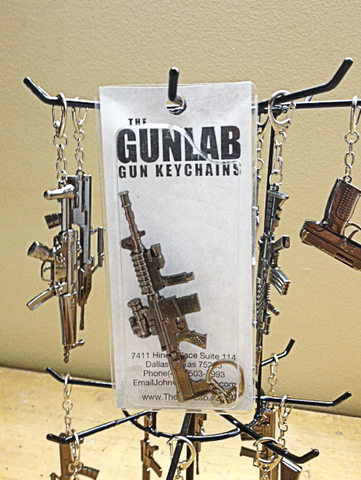 100 Gun Keychains with Display