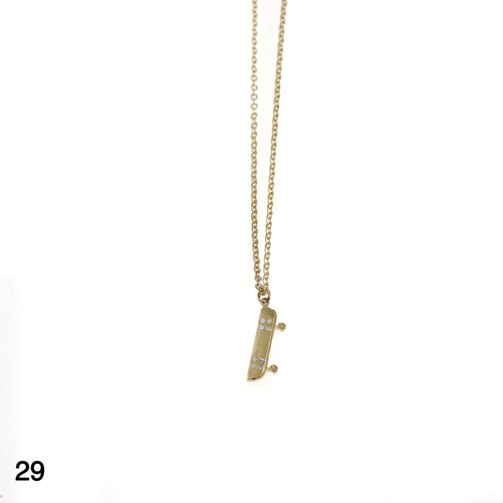 Skateboard with 8 stones necklace goldplated silver by Camilla Prytz Lux