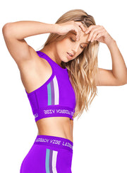 Neon purple athletic crop top, tank top style, blue, purple and white stripes along either side of top, racerback with small opening, by Babalu Fashion sold by ironangelsfashion.com | Top atlético de neón morado, crop top,  estilo de top sin mangas, raya azul, morada y blanca a lo largo de ambos lados del top, racerback con abertura pequeña en la espalda