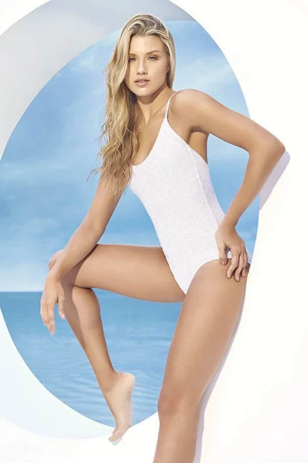 Cute and forward white one-piece bikini with thin shoulder straps