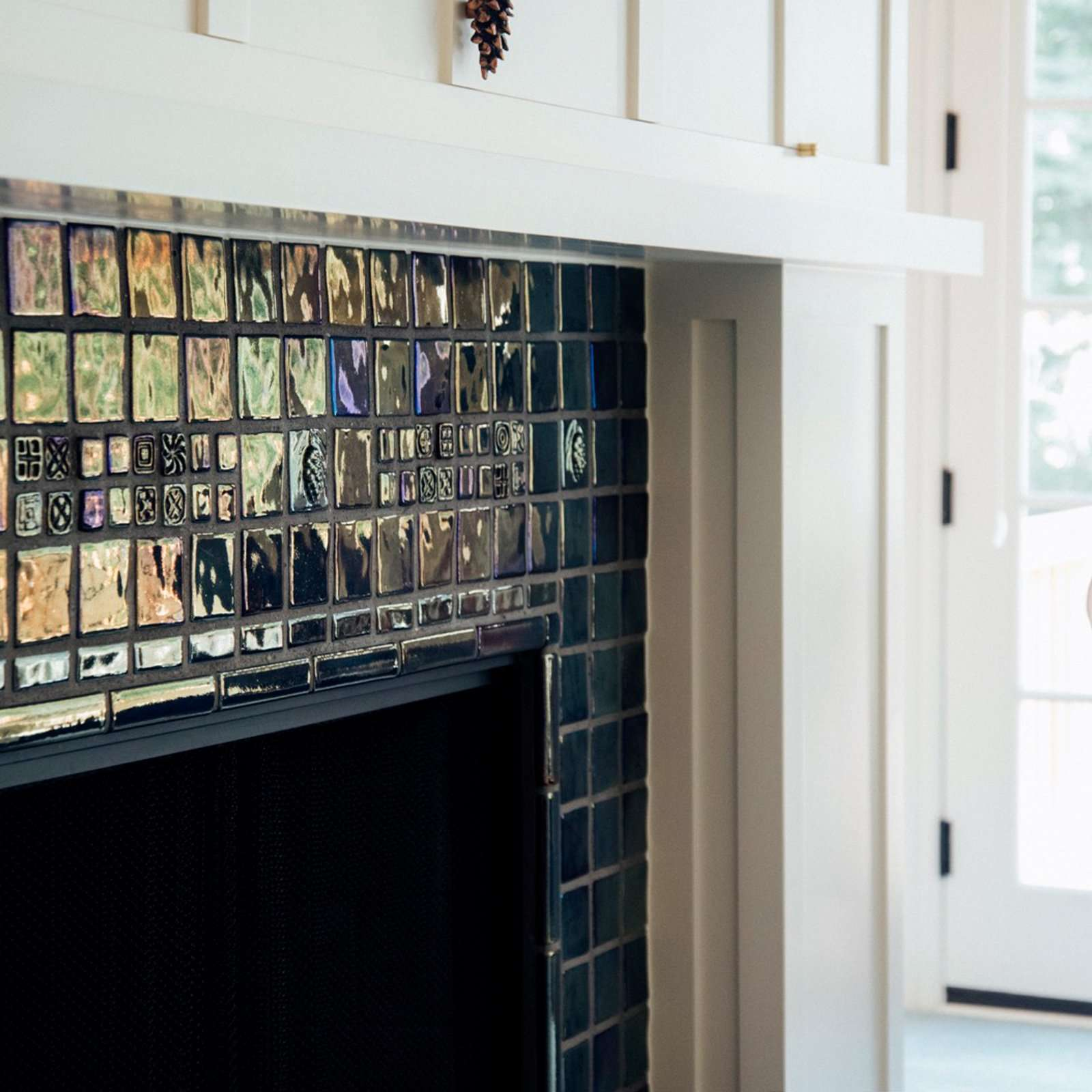 Iridescent Fireplace with 2x2 accents - | Pewabic Pottery