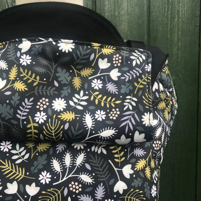 Love good, black white and yellow flower Integra baby carrier