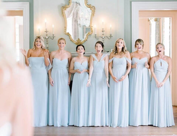 A group of bridesmaids in different dresses, but the same color.