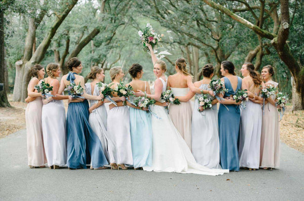 Different dresses with the same texture is a great way to mix and match bridesmaids dresses.