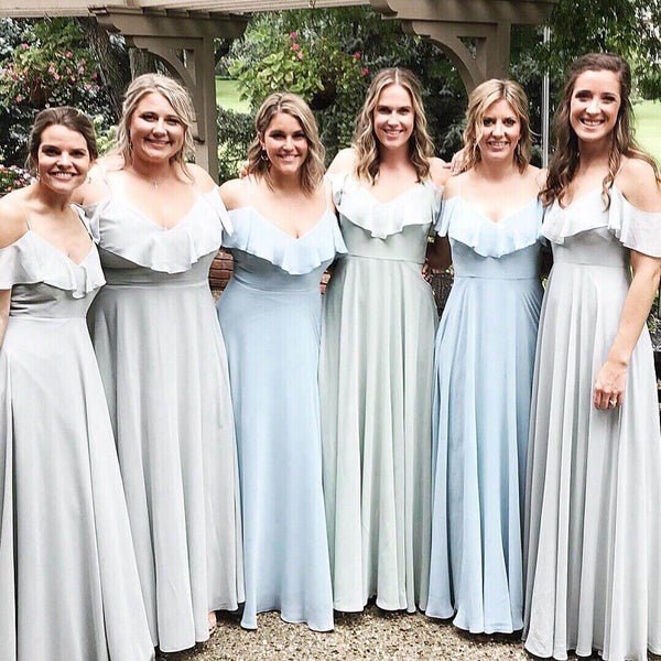 Bridesmaids in the same dresses,  but with two coordinating colors.
