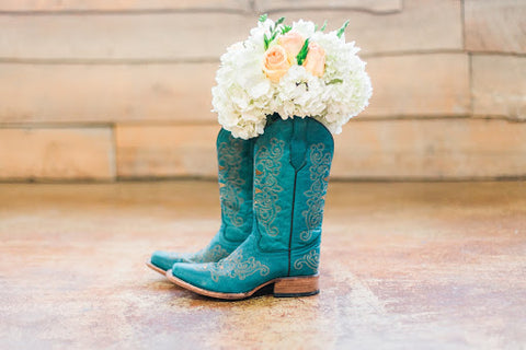 Cowboy boots for a barn wedding