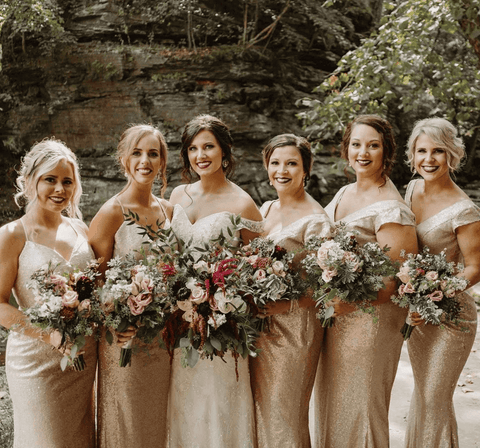 Bride and bridesmaids wearing gold dresses and bold red lipstick