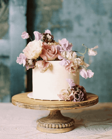 white wedding cake with flowers on it