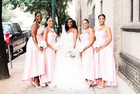 Bride and bridesmaids taking wedding photos