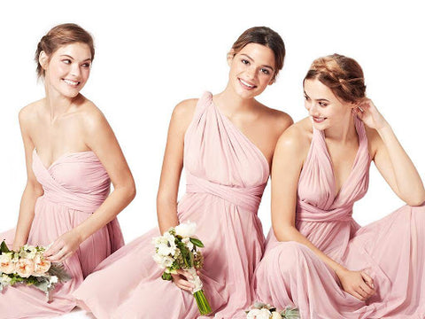 Bridesmaids wearing convertible maxi dresses