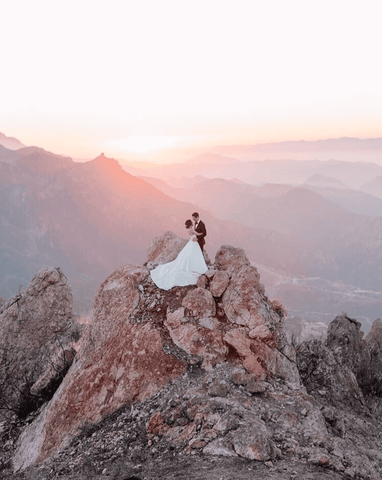 Couple getting married on a mountain cliff