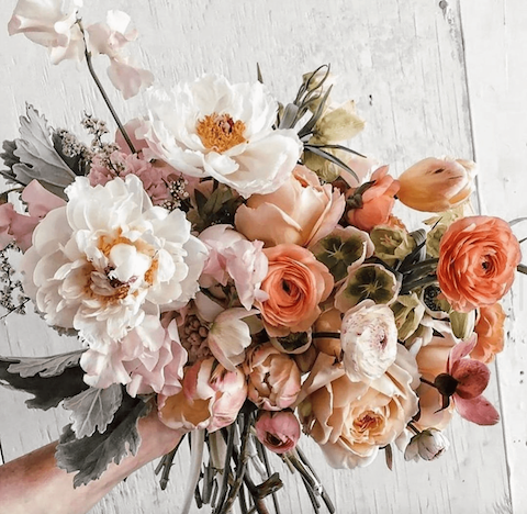 White bouquet with orange flowers