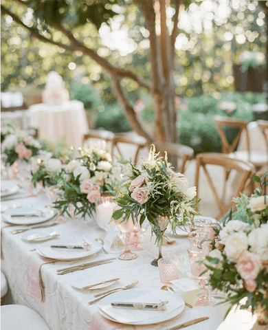 Rented tables, chairs, plates, and silverware for backyard wedding