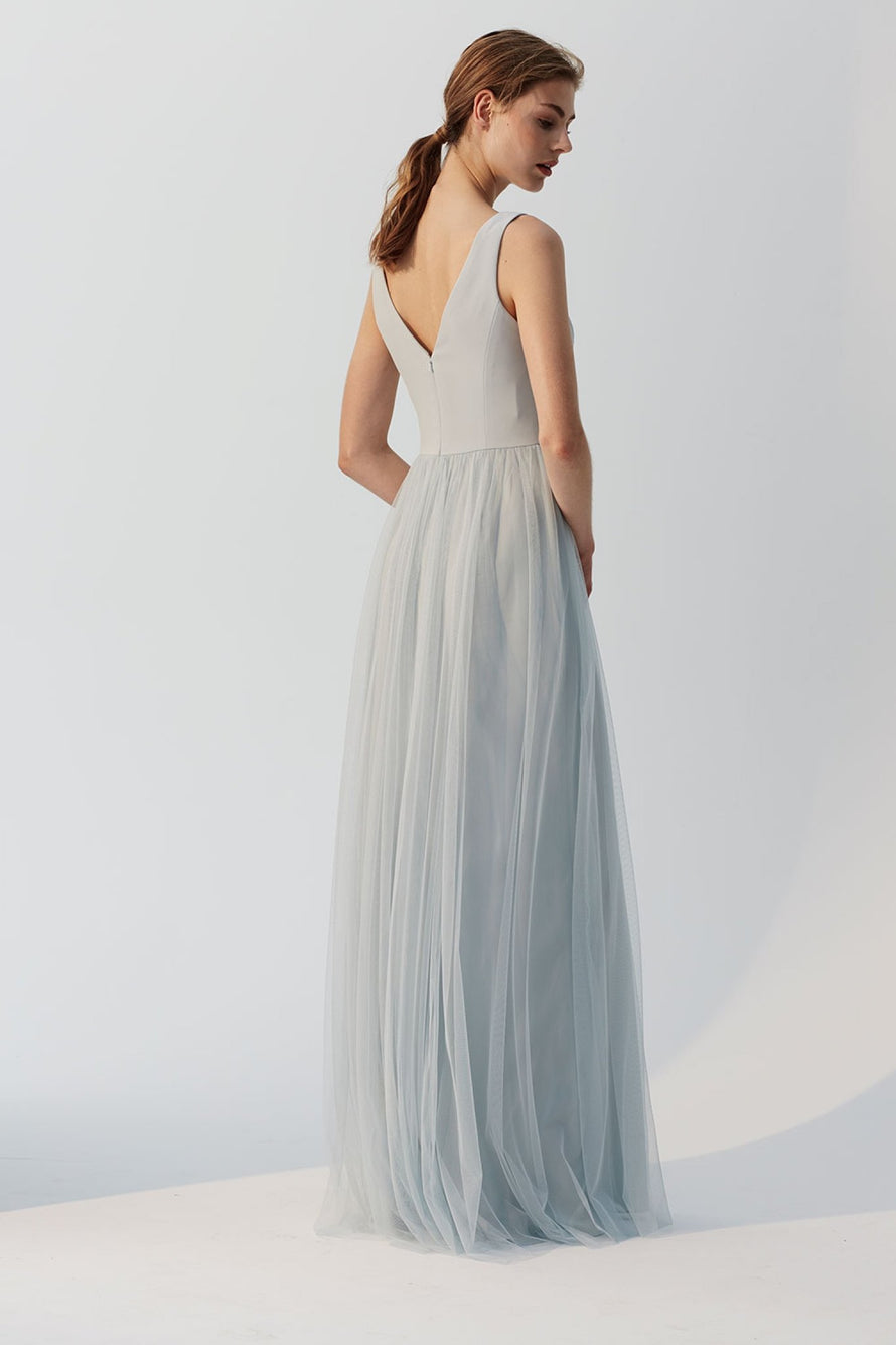 Deep V in the front and back crepe bodice and tulle skirt