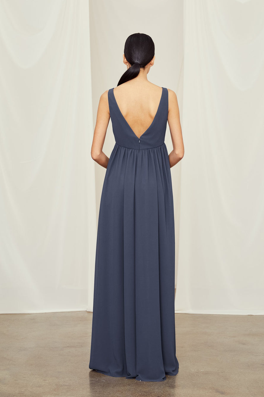 deep Vs in the front and back and delicate ruching at the empire waist in flat chiffon