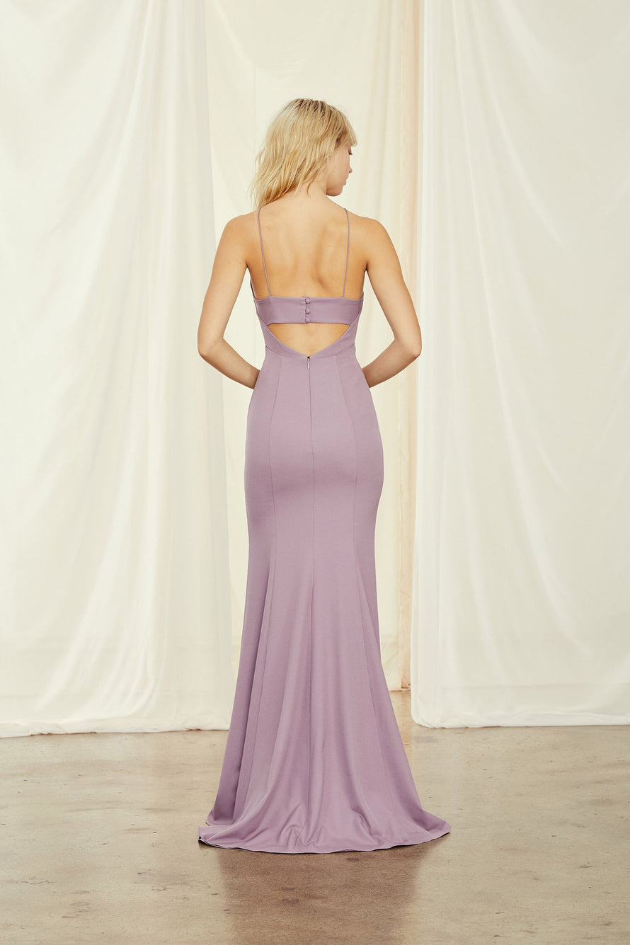 High neckline with open keyhole back, fit-to-flare dress with slit in crepe