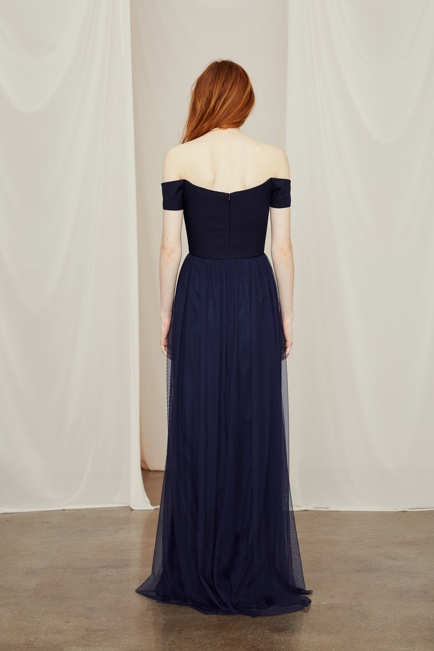 off-the-shoulder crepe bodice contrasts a skirt of airy gathered tulle on this bridesmaid dress