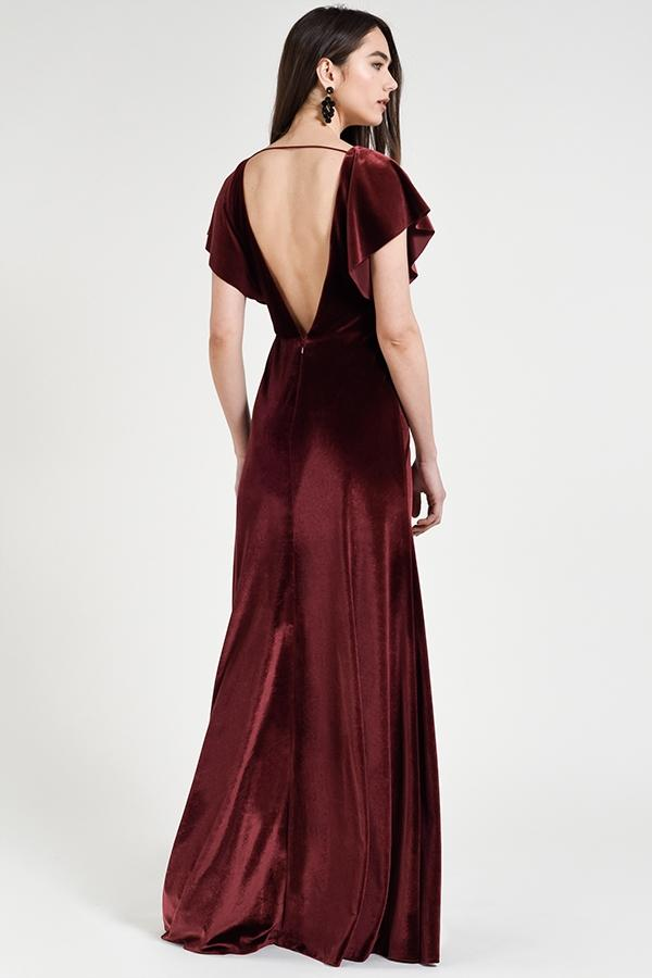 plunging v-neck with cascading flutter sleeve in stretch velvet