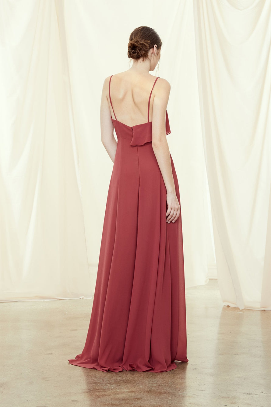 Spaghetti strap bridesmaids dress with asymmetrical ruffle and cutouts