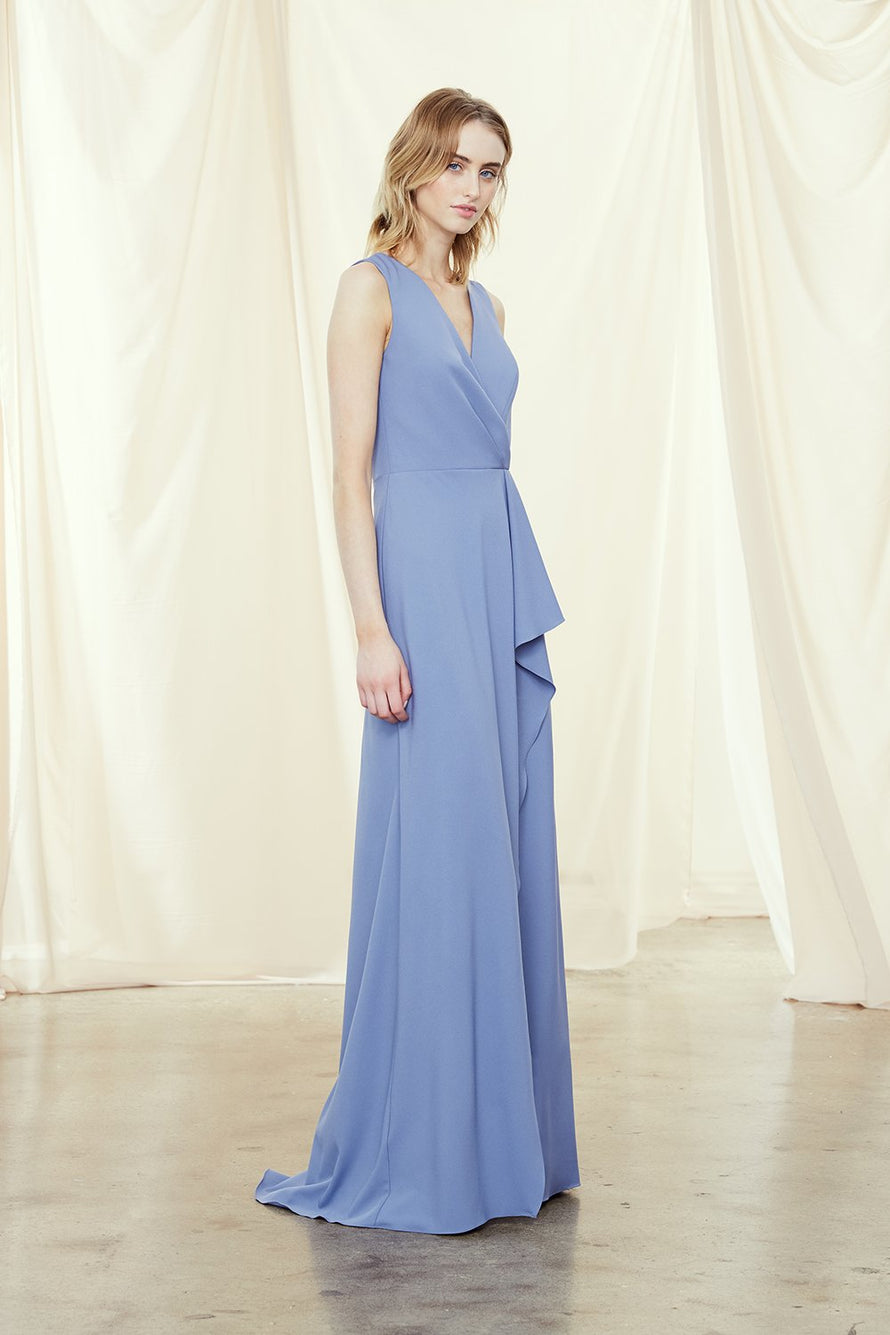 Bridesmaids dress with wrap neckline and cascading ruffle skirt with slit in crepe
