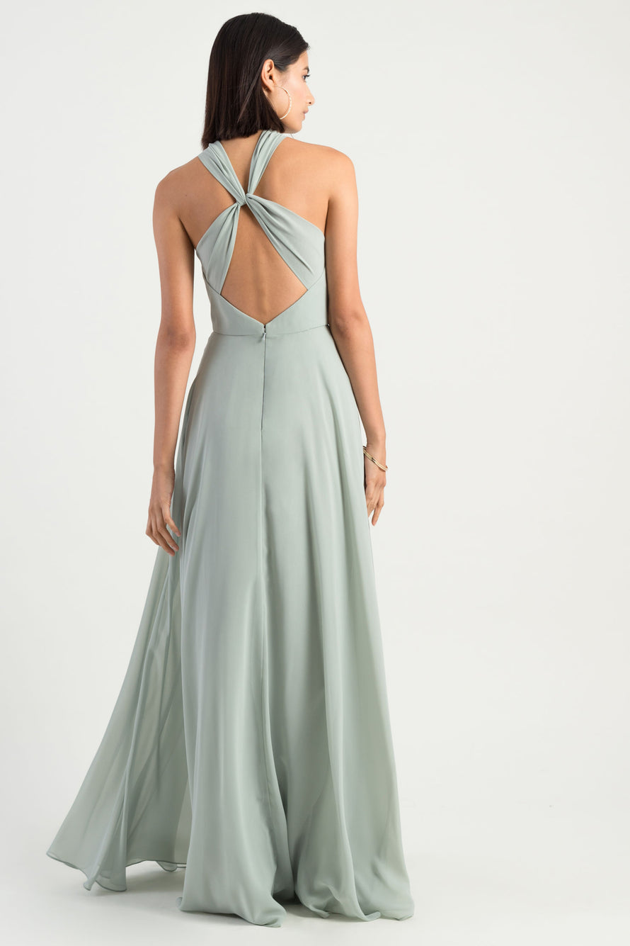 high halter neckline with a unique twist back detail in flowy luxe chiffon