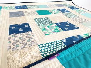 The designer in Green,  Quilted playmat